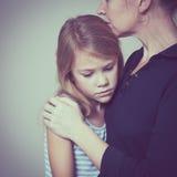 Sad daughter hugging his mother Stock Photo