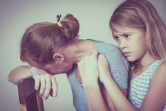 Sad daughter hugging his mother. At home. Concept of couple family is in sorrow stock images