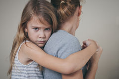 Sad daughter hugging his mother at home. Concept of couple family is in sorrow royalty free stock photos