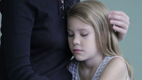 Sad daughter hugging his mother at home. stock footage