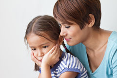 Sad daughter and understanding mother. Sad daughter with understanding and caring mother, good family life Royalty Free Stock Photos
