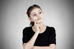 Sad daydreaming little girl Stock Photography