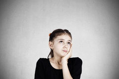 Sad daydreaming little girl Royalty Free Stock Images