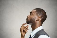 Sad daydreaming, thinking businessman Stock Photo