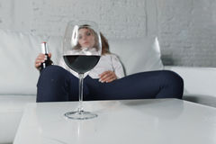 Sad depressed alcoholic drunk woman drinking at home in housewife alcohol abuse and alcoholism Stock Photo