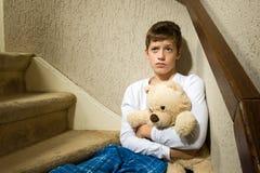 Sad and depressed boy in corner Stock Photography