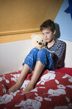 Sad and depressed boy on his bed Royalty Free Stock Photography