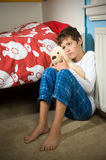 Sad and depressed boy on his bedroom Stock Photography