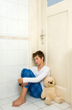 Sad and depressed boy Stock Images