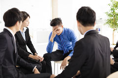Sad and depressed business man  during meeting Royalty Free Stock Photos