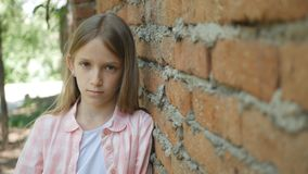 Sad Depressed Child Looking in Camera, Bored Girl Portrait, Unhappy Kid Face.  stock photos