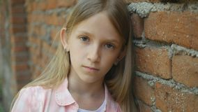 Sad Depressed Child Looking in Camera, Bored Girl Portrait, Unhappy Kid Face.  royalty free stock photography