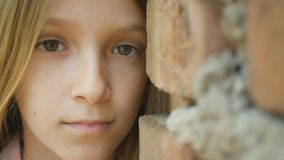 Sad Depressed Child Looking in Camera, Bored Girl Portrait, Unhappy Kid Face.  stock photography