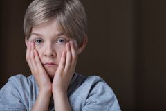 Sad depressed child Stock Photos