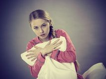 Sad depressed girl in bed gripping pillow Stock Photo