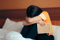 Sad Depressed Girl Crying After Break-up Holding Framed Picture stock photos