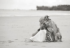 Sad depressed grieving woman sitting alone on empty beach Royalty Free Stock Image