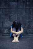 Sad and depressed little girl Stock Image