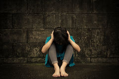 Sad and depressed little girl stock photography