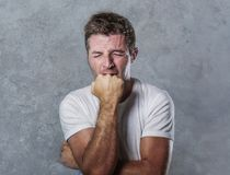 Sad and depressed man biting his fist desperate feeling frustrated and helpless in depression and sadness facial expression concep. Portrait of sad and depressed Royalty Free Stock Image