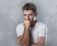 Sad and depressed man biting his fist desperate feeling frustrated and helpless in depression and sadness facial expression concep. Portrait of sad and depressed royalty free stock photo