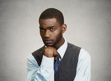 Sad, depressed man. Closeup portrait man with sad expression, isolated on grey, black background. Human emotions, body language, life perception Royalty Free Stock Images