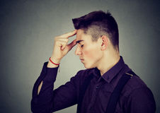 Sad depressed man resting head on hand worried Stock Image
