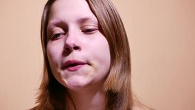Sad depressed teen girl almost crying. 4K UHD. Native video stock video footage