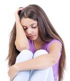 Sad depressed teen girl. On white background Royalty Free Stock Photo