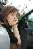 Sad and depressed woman in car Stock Photography