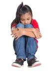 Sad And Depressed Young Asian Girl VI. Sad and depressed young Asian girl over white background Stock Image