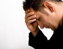 Sad depressed young businessman Stock Image