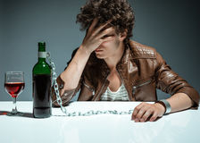 Sad and depressed young man in alcohol addiction Stock Images