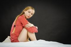 Sad depressed young woman in bed Stock Photos