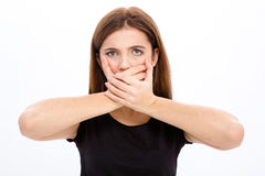 Sad depressed young woman covered her mouth with both hands Stock Photo
