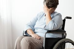 Sad disabled senior woman in a wheelchar stock photos