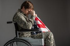 Despondent young american military man suffering from memories royalty free stock image