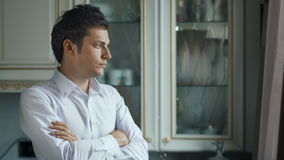 Sad disappointed man looking out of the window stock footage