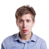 Sad disappointed man looking to camera isolated on white background. Facial expressions. Sad disappointed man looking to camera isolated on white background Royalty Free Stock Image