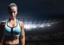 Sad disappointed woman athlete against staadium background. Digital composite of Sad disappointed woman athlete against staadium background Stock Photography