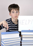 Sad and disappointed young boy and books Stock Photo