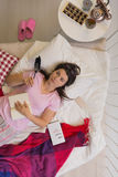 Sad divorcee lying in bed Royalty Free Stock Photography