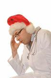 Sad Doctor with santa hat Royalty Free Stock Photography