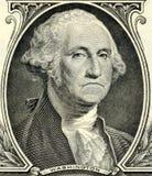 Sad dollar. Closeup of a sad George Washington from a One Dollar Bill Stock Image
