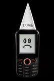 SAD dum telefon för dumhuvudframsidahatt Arkivfoton