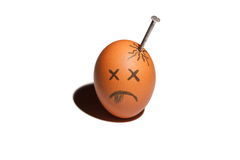 Sad egg character. With nail in in the head isolated over white background royalty free stock photography