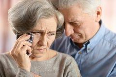 Sad elder couple Stock Photo