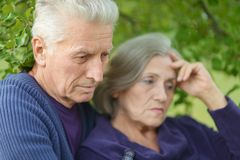 Sad elder couple Stock Photos