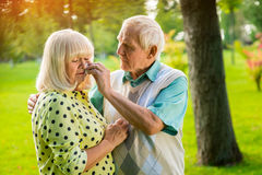 Sad elderly couple. Man wiping tears of woman. Grief in the family. Don't lose hope, my love Stock Photo
