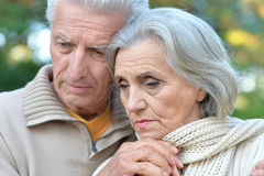Sad elderly couple in the park royalty free stock image